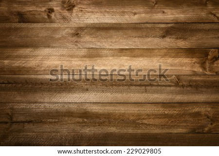 Perfect wood planks background with nice studio lighting and beautiful vignetting to draw the eyes into the picture - stock photo