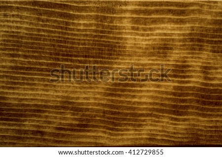 perfectly fine antique style wood surface background frame with vignette. with dark brown and warm yellowish colors, natural light, wave pattern texture - stock photo