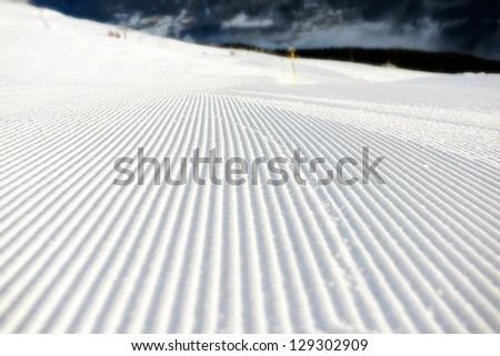 perfectly groomed empty  ski run - stock photo