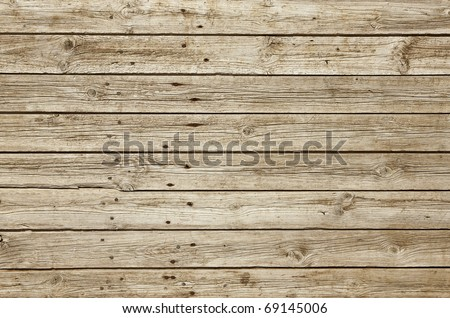 Perfectly lit wooden background with weathered wood and ruusty nails - stock photo
