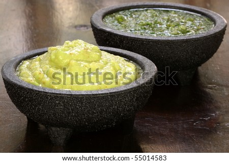 perfectly made mexican guacamole,prepared with fresh avocados lemo juice vinegar and hot and sweet peppers - stock photo