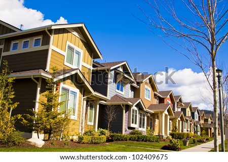 perfectly manicured suburban street on a beautiful sunny day - stock photo