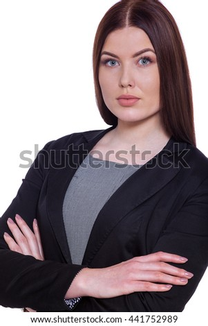 Perfectly suited to the business world. Confident businesswoman keeping arms crossed while standing against white background - stock photo