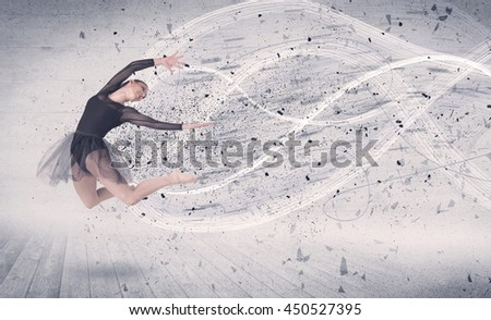 Performance ballet dancer jumping with energy explosion grungy particles concept on background - stock photo