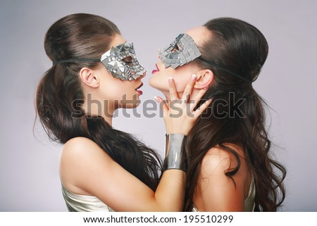 Performance. Fancy Women in Surrealistic Stylized Silver Masks - stock photo