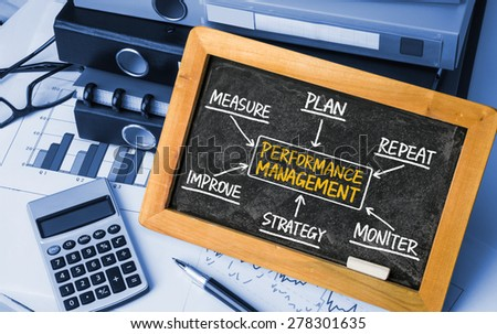 performance management flowchart concept hand drawing on blackboard - stock photo