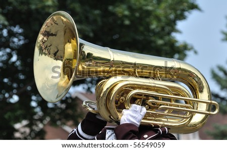 Performer Playing A Marching Tuba in Parade - stock photo