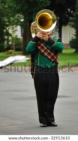 Performer Playing Marching Tuba in Parade, Copy Space,vertical - stock photo