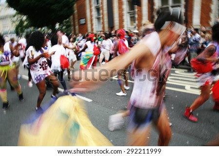 Performers, first day of Notting Hill Carnival, motion blurred, dancing in the street.