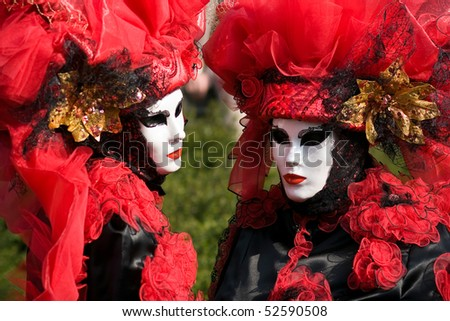 Performers in costume gathered on a quay of the river Seine for a Venetian carnival parade in Paris, France