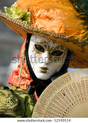 Performers in costume gathered on a quay of the river Seine for a Venetian carnival parade in Paris, France - stock photo