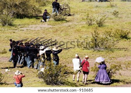 Performers participate in a civil war battle enactment. - stock photo