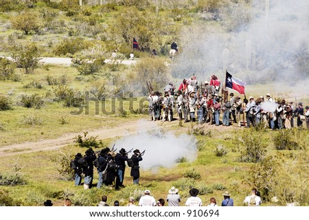 Performers participate in a civil war battle enactment. - stock photo