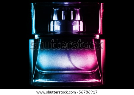perfume bottle against black background