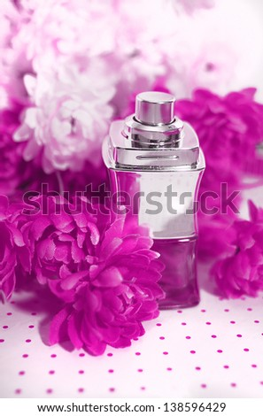perfume bottle and flowers - stock photo