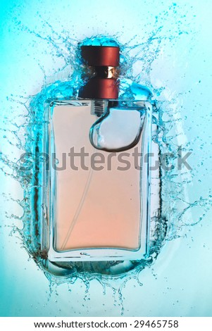 Perfume bottle and water splash around it - stock photo