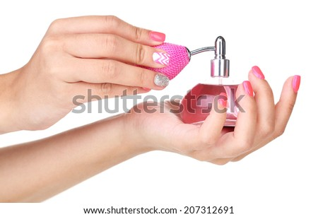 Perfume bottle in hands isolated on white - stock photo