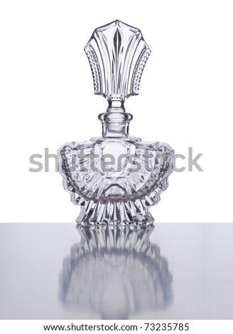 perfume bottle made of crystal glas isolated on white - stock photo