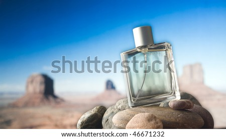 Perfume Bottle on Rocks