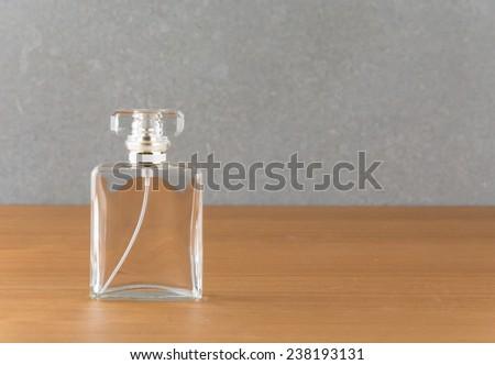 perfume bottle style on wood table - stock photo