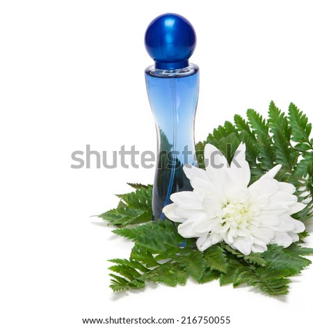 Perfume bottle with white flower and fern leaves on white background - stock photo