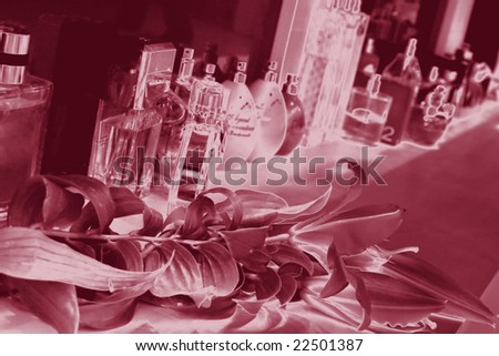 perfume bottles behind and lily  with imposition of effect of silk ...blur ... very interesting background