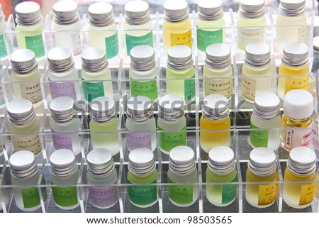 Perfume bottles in various colors - stock photo
