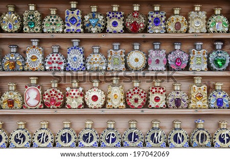 perfume bottles on a shelf  - stock photo