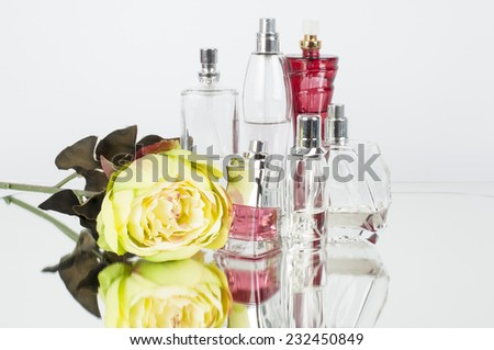 Perfume Bottles on mirror - stock photo