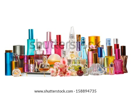 Perfume bottles with pink orchid flower isolated on the white background - stock photo