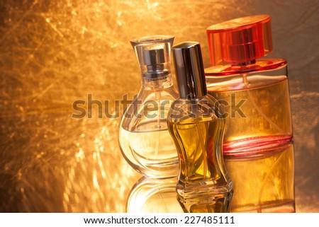Perfume bottles with reflection - stock photo