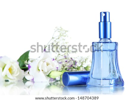 Perfume in bottle and flowers isolated on white - stock photo