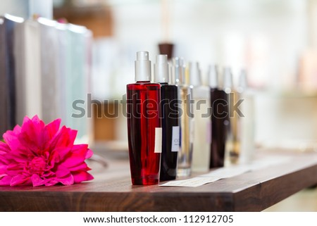 Perfume in drugstore or shop for testing - stock photo