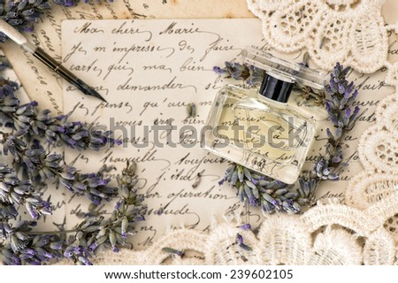 perfume, lavender flowers, vintage ink pen and old love letters. retro style toned picture - stock photo