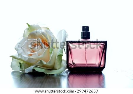 perfume on a white background - stock photo