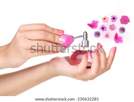 Perfume with flower aroma isolated on white - stock photo