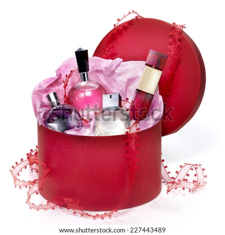 Perfumery gift set in a red box on white background.  - stock photo