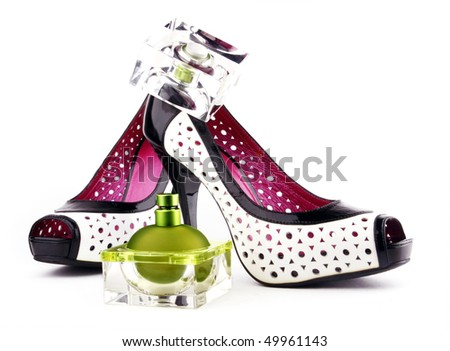 Perfumes and Shoes.  Femininity accessories on a white background. - stock photo