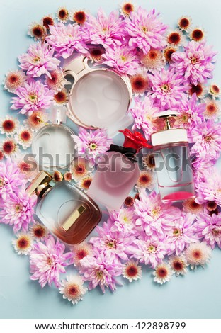 perfumes with beautiful bottles in pan on a blue background with shadows - stock photo