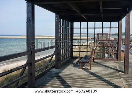 Pergola at boardwalk promenade in Hel town, overlooking Baltic Sea coast, Hel Peninsula, Poland - stock photo