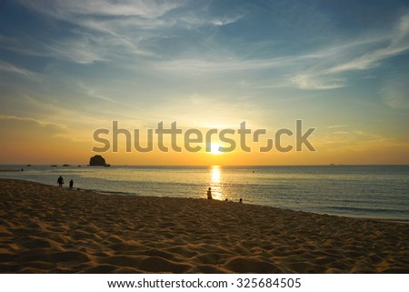 PERHENTIAN, MALAYSIA - 27TH MAY 2013; View of sunset over beach at Perhentian island in Malaysia.  - stock photo