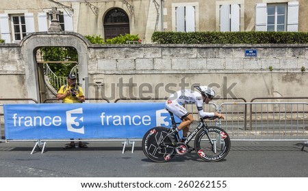 PERIGEUX,FRANCE-JUL 26: The French cyclist Arnaud Gerard ( Bretagne-Seche EnvironnementTeam) pedaling during the stage 20 ( time trial Bergerac - Perigueux) of Le Tour de France 2014.  - stock photo