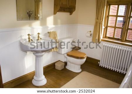 Period bathroom in a traditional cottage - stock photo