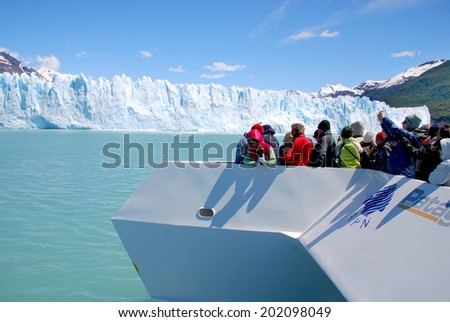 PERITO MORENO GLACIER, ARGENTINA - NOV 17: Tourists boat in front the Perito Moreno glacier on Nov 17 2011 in Los Glaciares National Park, Patagonia, Argentina - stock photo