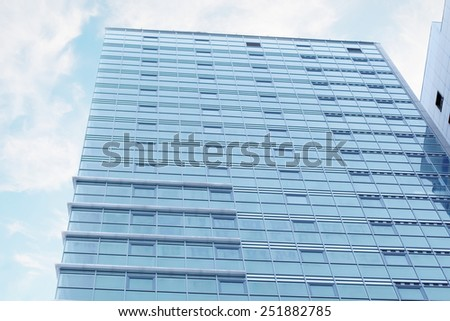 PERM, RUSSIA - JAN 11, 2013: Residential complex Gates of Prikamye. More than 23 000 square meters Glass used for facade glazing 27-storey residential building - stock photo