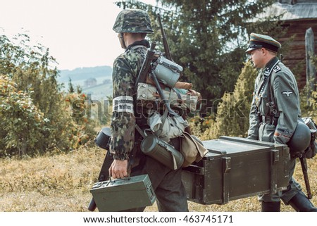 "PERM, RUSSIA - JULY 30, 2016: ""Perm Regional Museum"", Historical reconstruction of second world war. Two soldiers in German uniform carrying a box of grenades."