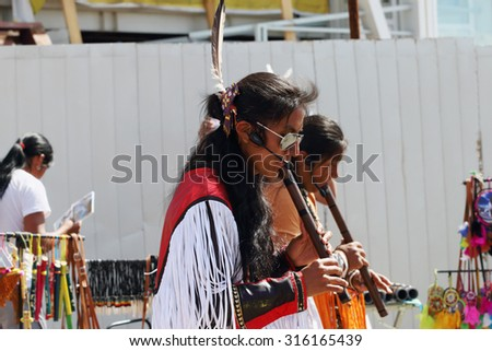 PERM, RUSSIA - JUNE 21, 2014: Camuendo Wuambrakuna Indian band performs on street  - stock photo