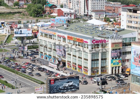 PERM, RUSSIA - JUNE 25, 2014: Modern shopping complex Iceberg. More than 60 stores in Iceberg are collections of famous brands of clothes