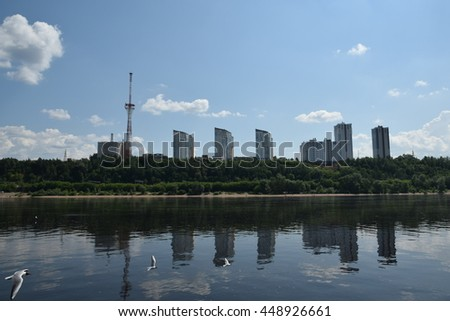 Perm, Russia - 21 June 2016. New residing tower houses on the hilly bank of the Kama River and the Television Tower