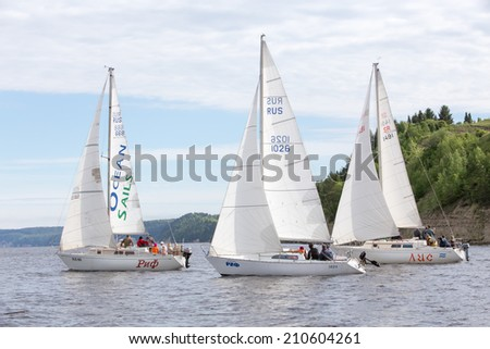 "Perm, Russia - June 28,2014. Sailing regatta ""Kama lights 2014"".several sailing yachts with people on river day"